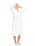 Young woman in bathrobe enjoying freshness Stock Image