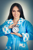 Young Woman in Bathrobe Holding an Alarm Clock Royalty Free Stock Photos