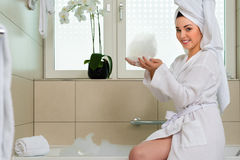 Young woman in bathrobe in hotel bathroom Royalty Free Stock Photography