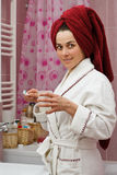 Young woman in bathroom Stock Images