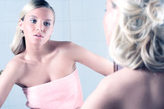Young woman in bathroom Stock Image