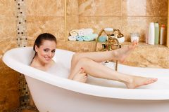 Young woman in a bathroom. Royalty Free Stock Photography