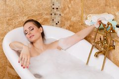 Young woman in a bathroom. Royalty Free Stock Image
