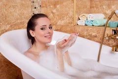 Young woman in a bathroom. stock photos