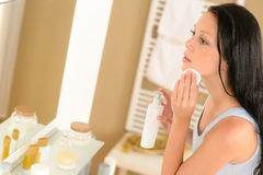 Young woman bathroom clean face make-up removal Stock Photo