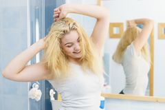 Woman stretching in bathroom. Young woman in bathroom stretching her body after long night. Morning great mood, fresh, good sleep royalty free stock photos