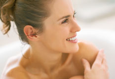 Young woman in bathtub. Plenty of copy space stock photos