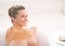 Young woman in bathtub Stock Images