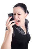 Young woman bawling in her smart phone Royalty Free Stock Photography