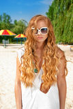 Young woman at beach. Young blond woman in sunglasses at the beach stock photography