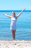 Young woman on the beach Stock Image