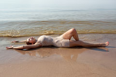 Young woman at the beach. Royalty Free Stock Photo