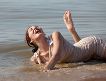 Young woman at the beach. Stock Image
