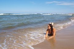 Young woman at beach Stock Images