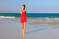 Young woman on a beach Royalty Free Stock Photos