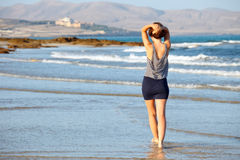 Young woman on the beach Royalty Free Stock Images