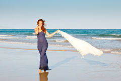 Young woman on the beach Stock Images