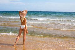 Young woman at beach Stock Photography
