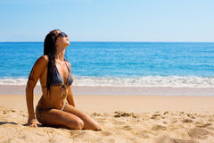 Young woman on the beach Stock Photos