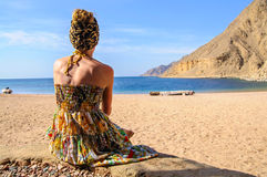 Young woman on the beach. Young woman enjoing the landscape of the beach and sea Stock Photography