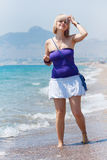 Young woman on a beach. Walking in the water Royalty Free Stock Photo