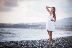Young woman on the beach Royalty Free Stock Image