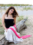 Young woman at the beach royalty free stock photo