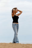 Young woman at beach. Young woman with arms up at beach stock images