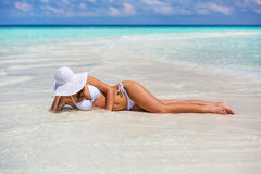 Young woman on the beach. Young woman in bikini relaxing on the beach royalty free stock photo