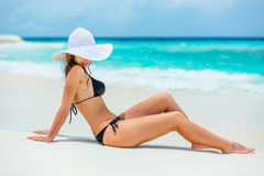 Young woman on the beach. Young woman in bikini sitting on the beach stock images