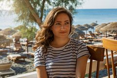 Young woman at the beach cafe Royalty Free Stock Photography