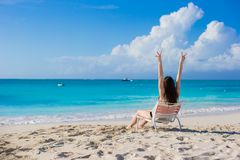 Young woman in beach chair during her summer Stock Images