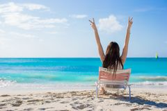 Young woman in beach chair during her summer Royalty Free Stock Images