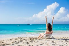 Young woman in beach chair during her tropical Stock Image