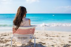 Young woman in beach chair during her tropical Stock Images