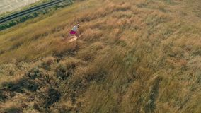 Young woman doing sports outdoors, yoga. aerial video stock footage