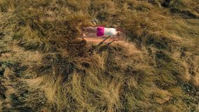 Young woman doing sports outdoors, yoga. aerial video stock video
