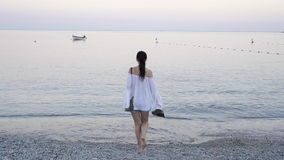 Young woman on the beach in european vacation on the Ligurian coast. Young woman enjoying summer day on the beach stock video