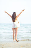 Young woman on beach in the evening rejoicing Royalty Free Stock Photos