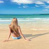 Young woman on beach Royalty Free Stock Photos