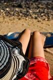 Young woman on beach Stock Photos