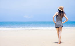 Young woman on the beach. Young woman and beach hat on tropical beach royalty free stock photos
