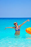 Young woman at the beach. Young woman having fun in the water Stock Images