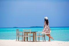 Young woman on beach during her summer vacation Royalty Free Stock Photography