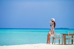 Young woman on beach during her summer vacation Stock Image