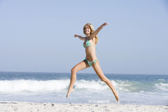 Young woman on beach holiday Royalty Free Stock Images