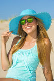 Young woman on the beach with pamela and blue shirt Stock Photo