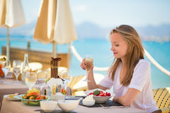 Young woman in a beach restaurant Royalty Free Stock Photography