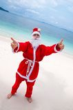 Young woman on the beach in santa's costume Stock Images