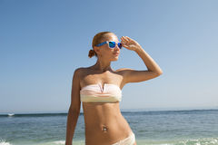 Young woman at the beach Stock Images